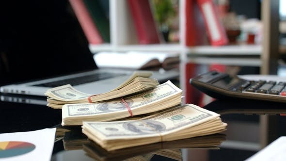 Thumbnail for Bundles of Money Dollars at Business Deal