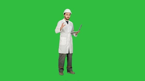 Thumbnail for Technical Working in Helmet Talking on Camera Hand Gestures  on a Green Screen, Chroma Key.
