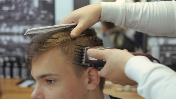 Thumbnail for A Young Guy Gets a Haircut and Hair Care Service