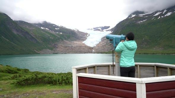 Thumbnail for Svartisen Glacier in Norway. Tourist Girl Looking Glacier.