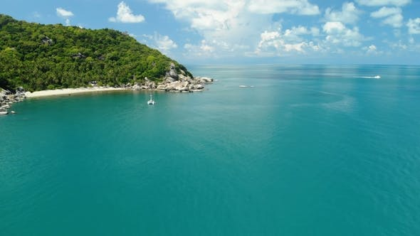 Cover Image for Flying Over Amazing White Sand Beach and Tropical Lagoon with Yacht