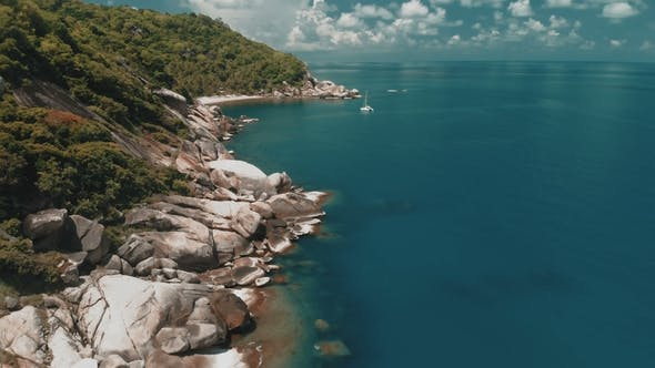 Thumbnail for Flying Over Amazing Rocky Beach and Tropical Lagoon with Yacht