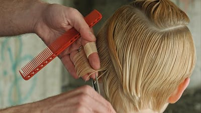 Beautyful Girl Getting Haircut. Conceptual.