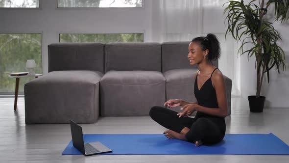 Woman Yoga Trainer Talking with Client Via Webcam