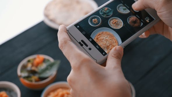 Thumbnail for Female Hands Take Photos of Indian Food By Smartphone