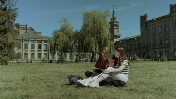 Thumbnail for Happy Female Students Relaxing on Campus Lawn