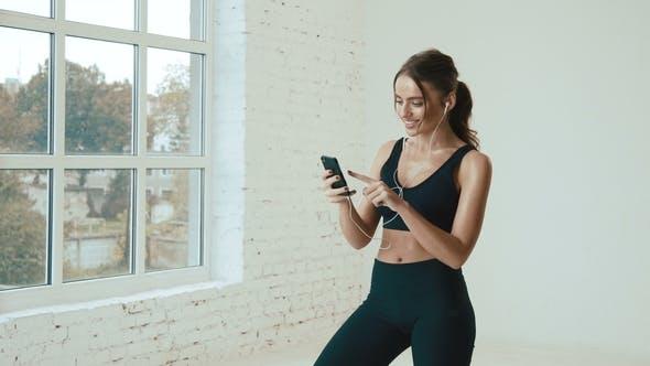 Thumbnail for Beautiful Girl Wearing Sport at Background Near Big Windows
