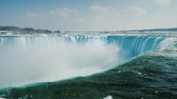 Thumbnail for Epic Scene of Niagara Falls. A Waterfall in the Shape of a Horseshoe, Ice Floes Float Along the