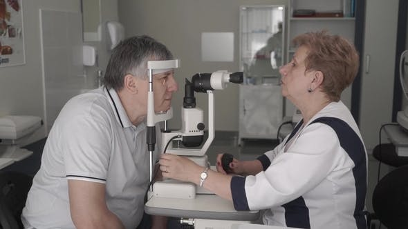 Thumbnail for Doctor Examining Eyesight of Adult Man with Modern Equipment
