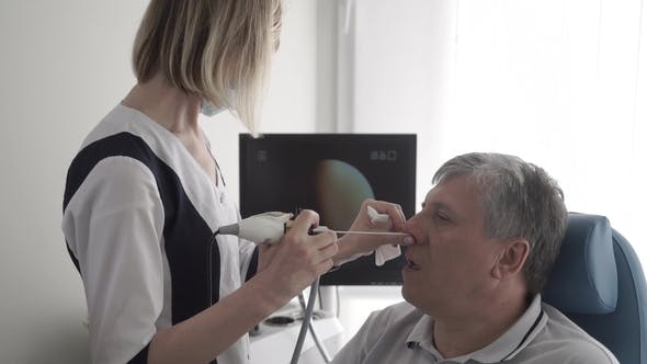Thumbnail for Doctor Check Nose of Elderly Man with ENT Telescope