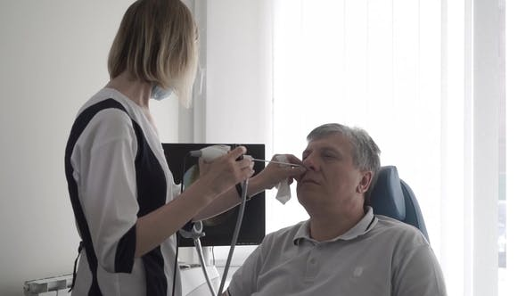 Thumbnail for Doctor Examine Nose of Old Man with Ent Telescope