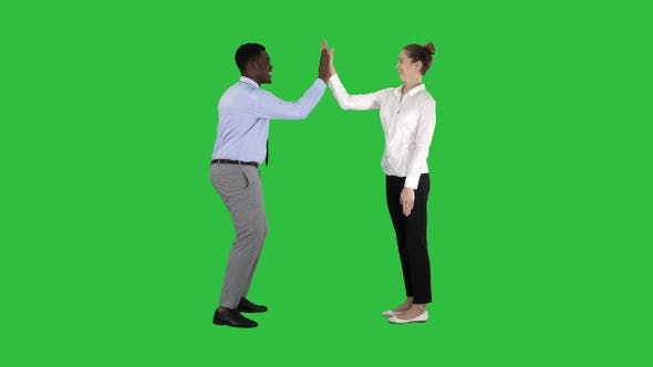 Thumbnail for Young woman and young man in formal clothes give high five