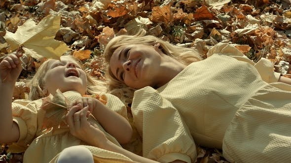 Thumbnail for Mother and Daughter in Autumn Yellow Park