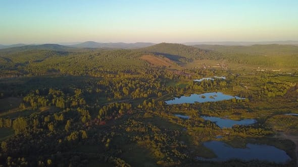 Thumbnail for Aerial Shot Rising Over the Treetops Revealing the Appalachian Mountain Range on a Bright Day