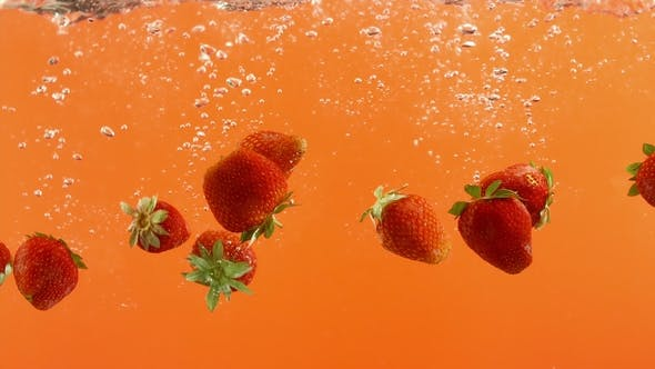 Thumbnail for Fresh Strawberry Fall Into Water on Orange Background. Summer Berries in Clean Liquid