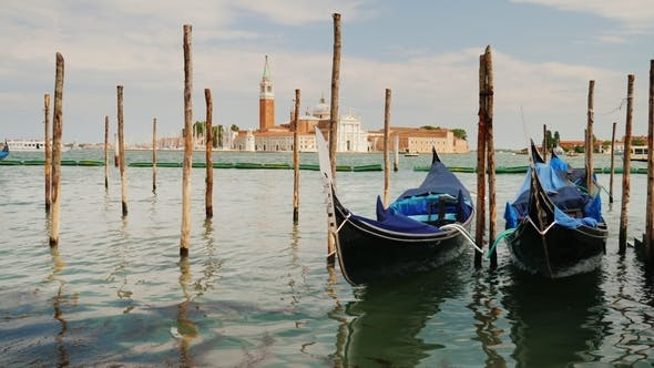 Thumbnail for The Symbol of Venice Is the Traditional Gondola Boat. Rock on the Waves, Moored Near the Shore