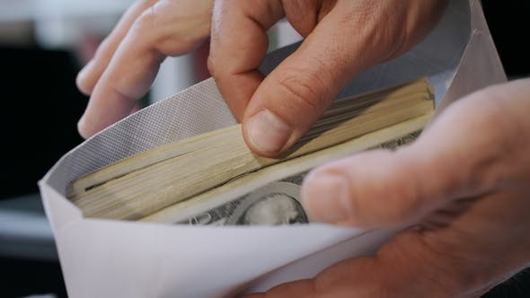 Thumbnail for Cash Money in Envelope in Hands. Money Bonus in Paper Envelope