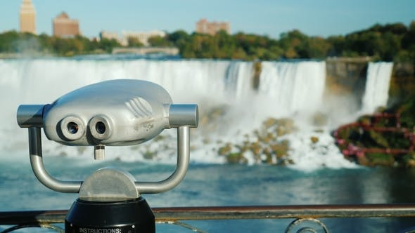 Thumbnail for With a Coin Operated Binoculars Overlooking the Niagara Falls