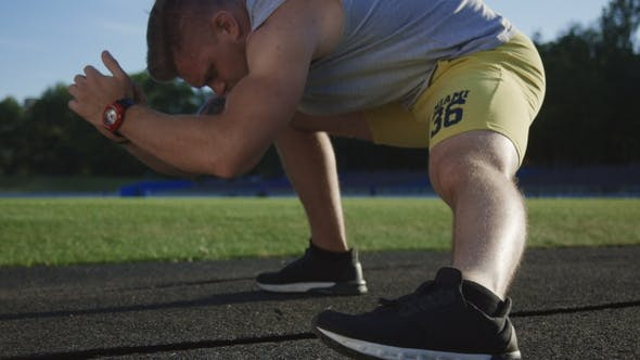 Thumbnail for Crop Athlete Stretching on Field