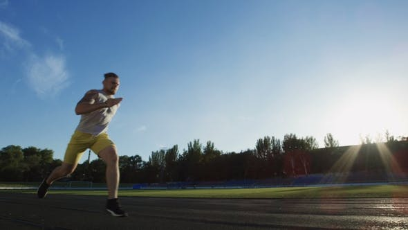 Thumbnail for Athletic Man Running Sprint on Racetrack