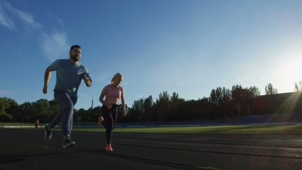 Thumbnail for Man and Woman Running Sprint on Time