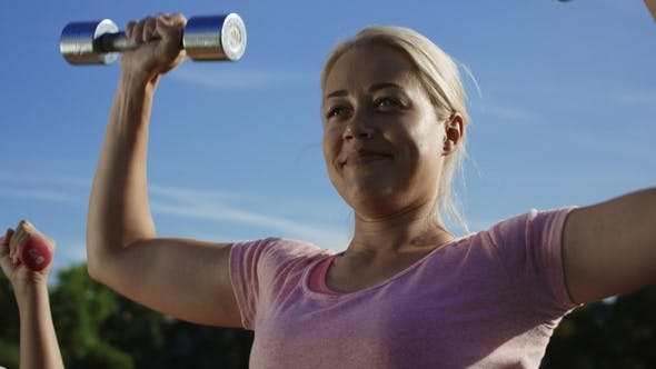 Thumbnail for Woman Training with Dumbbells in Sunlight