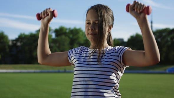 Thumbnail for Children Training with Dumbbells Outside