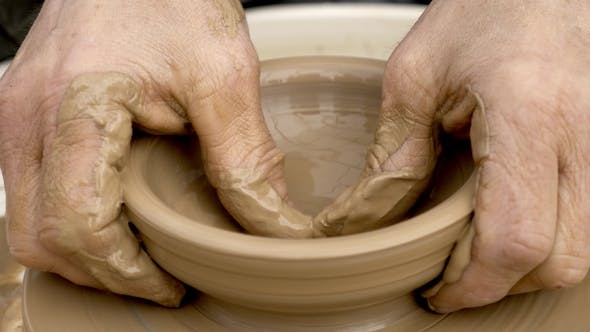 Thumbnail for Hands Working Clay on Potter