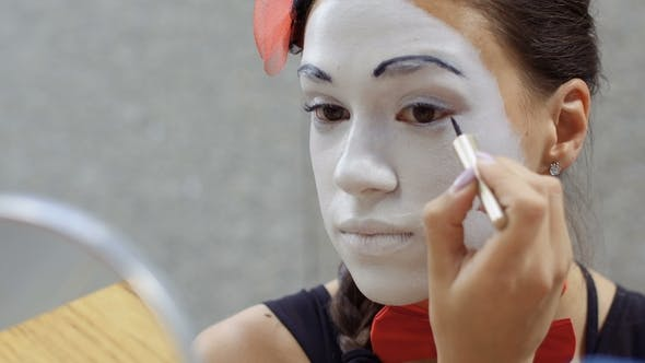 Thumbnail for Young Girl Mime Draw Black Lines on Her Eyelids