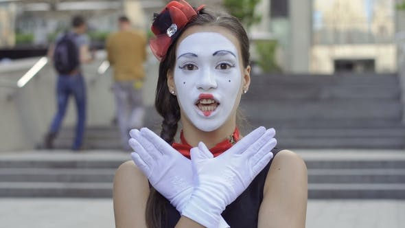 Thumbnail for Cute Girl Mime Playing with Hands on Camera