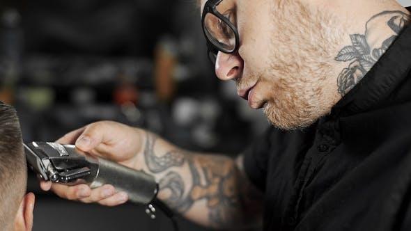 Thumbnail for Tattoed Barber Makes Haircut for Customer at the Barber Shop