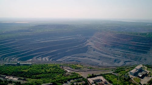 Aerial View of Opencast Mining Quarry with Lots of Machinery at Work