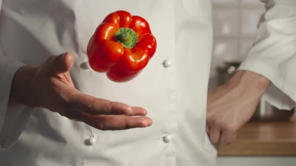 Thumbnail for Chief Throws Up A Red Bell Pepper In A Hand