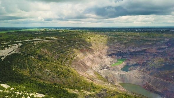Thumbnail for Aerial View Industrial of Opencast Mining Quarry with Lots of Machinery at Work - View From Above.