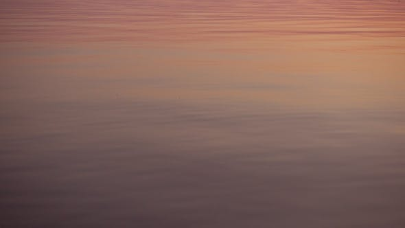 Thumbnail for Skipping Stone, Beautiful Sunset Reflect on Water Surface.