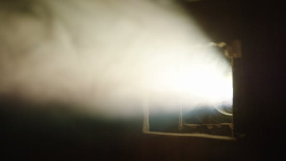 Thumbnail for Cinema Projector Lights in Dark Room with Smoke