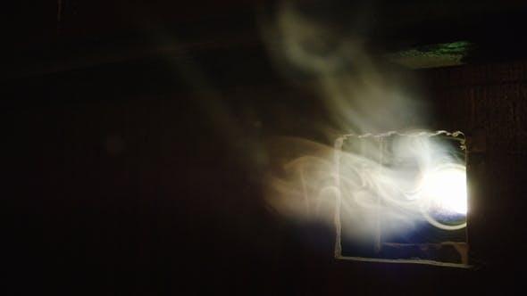 Dark Cinema Hall with Light Smoke and Projector