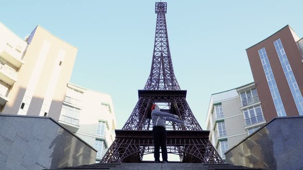 Thumbnail for Man Mime in Red Beret and Stripped Shirt Has Fun Near Eiffel Tower