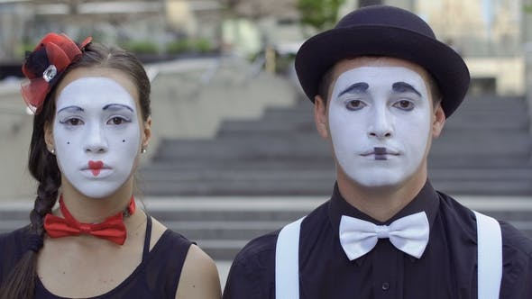 Man and Woman Mime Play Their Facial Expressions