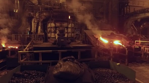 Thumbnail for Moving Shot in Foundry in Metallurgical Plant, Open Fire and Red-hot Metal in Blast Furnace