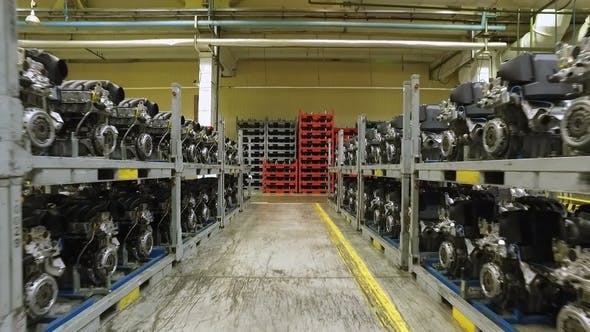 Thumbnail for Prepared Car Engines Are Standing in Warehouses Racks of Modern Automobile Factory, Moving Shot