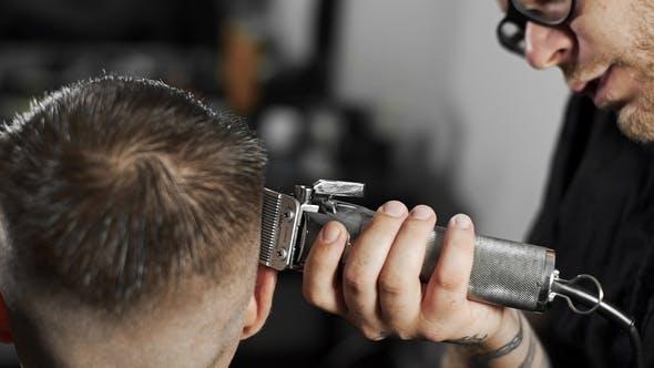Barber Makes Haircut for Customer