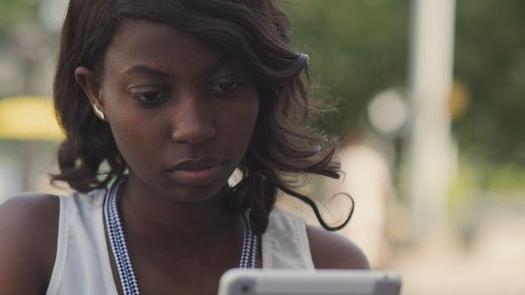 Thumbnail for African American Woman Using Her Tablet