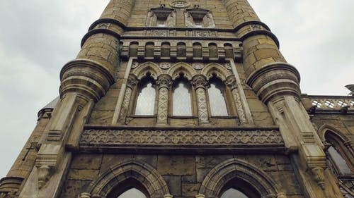 Facade of Tower of Building in Gothic-renaissance Style, Stained-glass Windows, Bas-reliefs