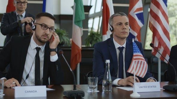 Thumbnail for Members of International Summit in Headphones