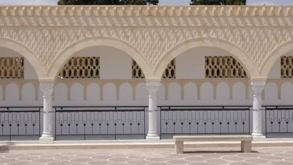 Thumbnail for Panorama Rows Columns with Arches on Square Habib Bourguiba in Monastir Tunisia. Dolly Shot Exterior
