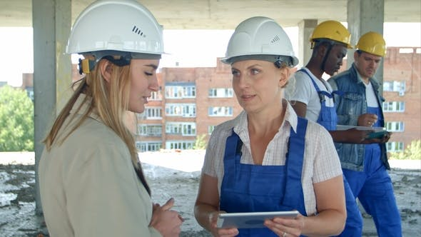 Thumbnail for Female Engineer and Worker on Construction Site with Plan on Digital Tablet