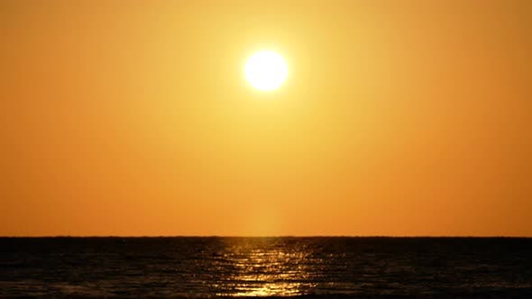 Thumbnail for Dramatic Orange Sunrise Over the Beach. Red Sky, Yellow Sun and Amazing Sea. Summer Sunset Seascape