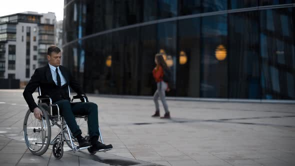 Thumbnail for Handsome Invalid Man Sitting Rolling in Wheelchair and Looking Depressed