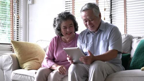 Senior using tablet